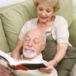 Wife Reading to Husband — Stock Photo