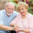 Disabled Senior Couple Outdoors — Stock Photo #6596652