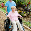 Stock Photo: Disabled Senior Woman and Nurse