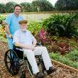 Nursing Home - Walk in the Garden - Stock Photo