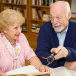 Stock Photo: Seniors Meet in Library