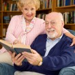 Seniors in Library — Stock Photo