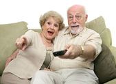 Seniors Entertained by TV — Stock Photo