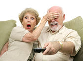 Seniors Shocked by TV — Stock Photo