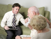 A counselor helping a grieving couple. The husband is crying. — Stock Photo