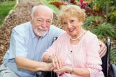 Disabled Senior Couple Outdoors — Stock Photo