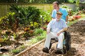 Disabled Senior Enjoying Garden — Stock Photo