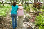 Helping Grandmother Walk — Stock Photo