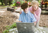 Seniors on Computer with Copyspace — Stock Photo