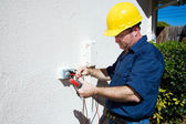 Electrician Measures Voltage — Stock Photo