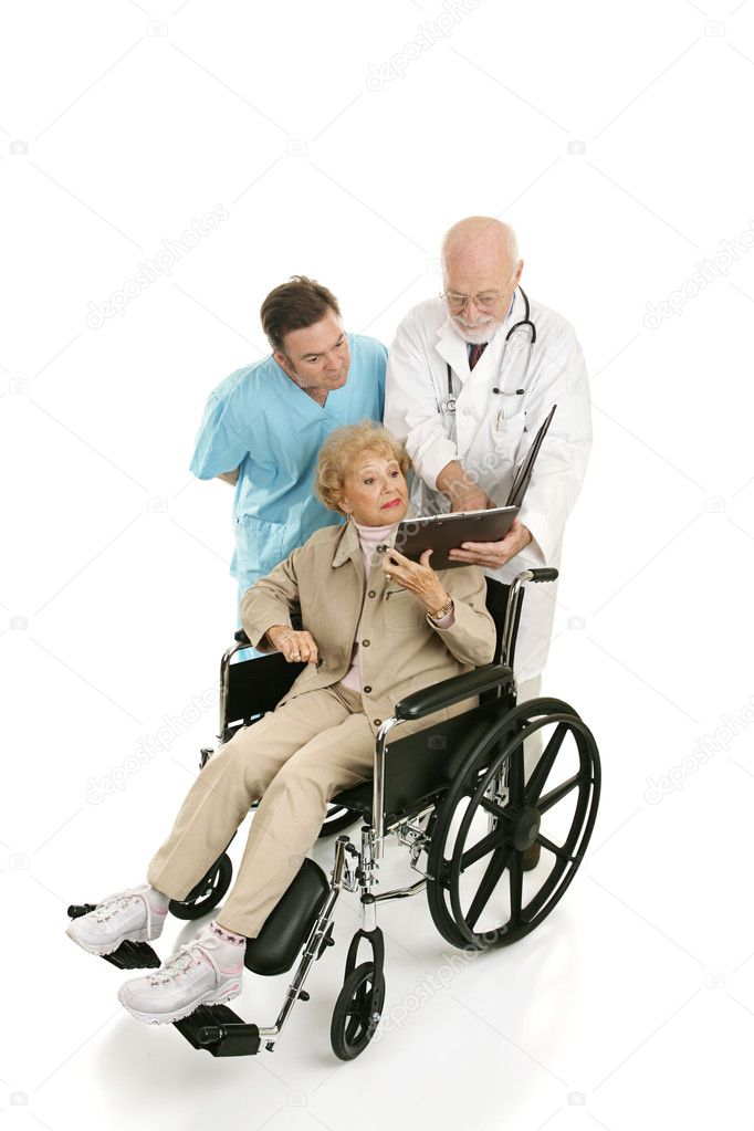 Senior woman in wheelchair discussing her chart with her doctors.  Full body isolated on white — Stock Photo #6595020
