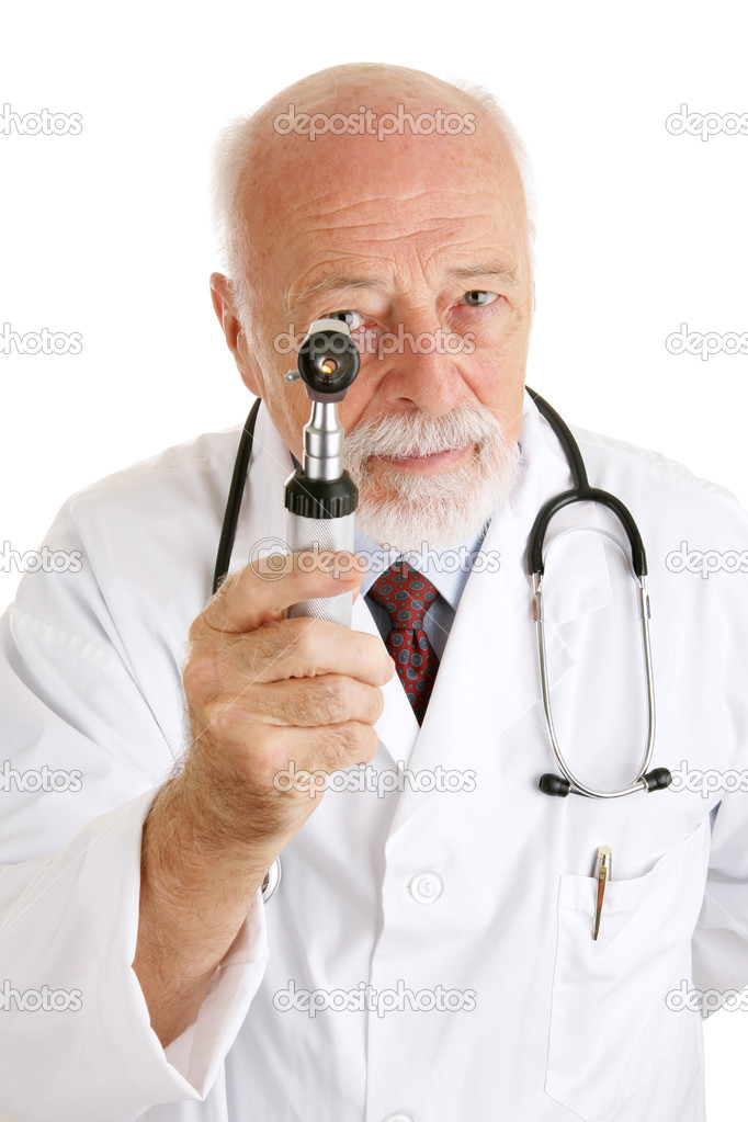 Handsome mature doctor examines you with his otoscope.  Isolated on white. — Stock Photo #6595033