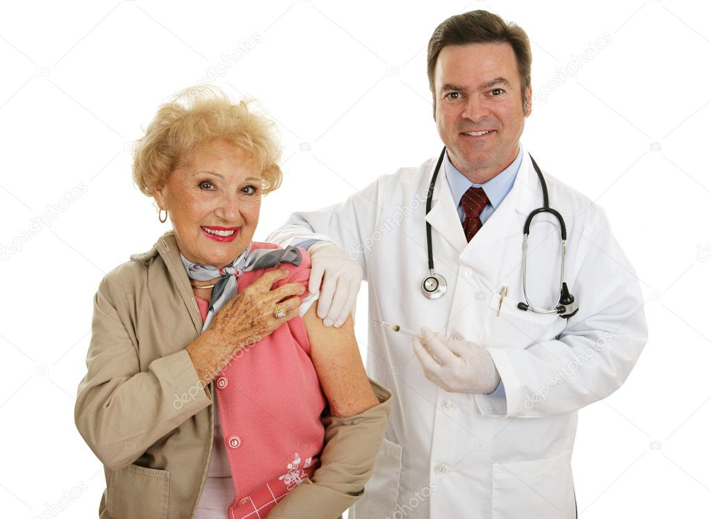 Senior woman receiving flu vaccine from a friendly doctor.  Isolated on white. — Stock Photo #6595047