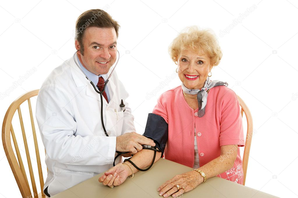 Doctor taking a senior woman's blood pressure.  Isolated on white.   — Stock Photo #6595134