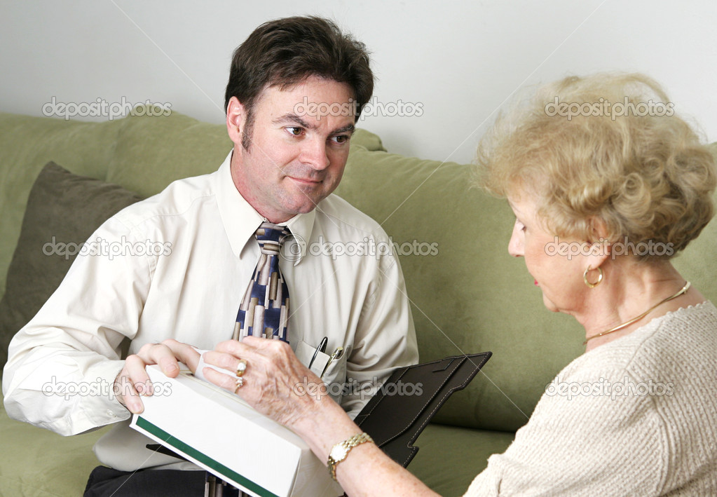 A sympathetic counselor offering an upset client a tissue. — Stock Photo #6596571
