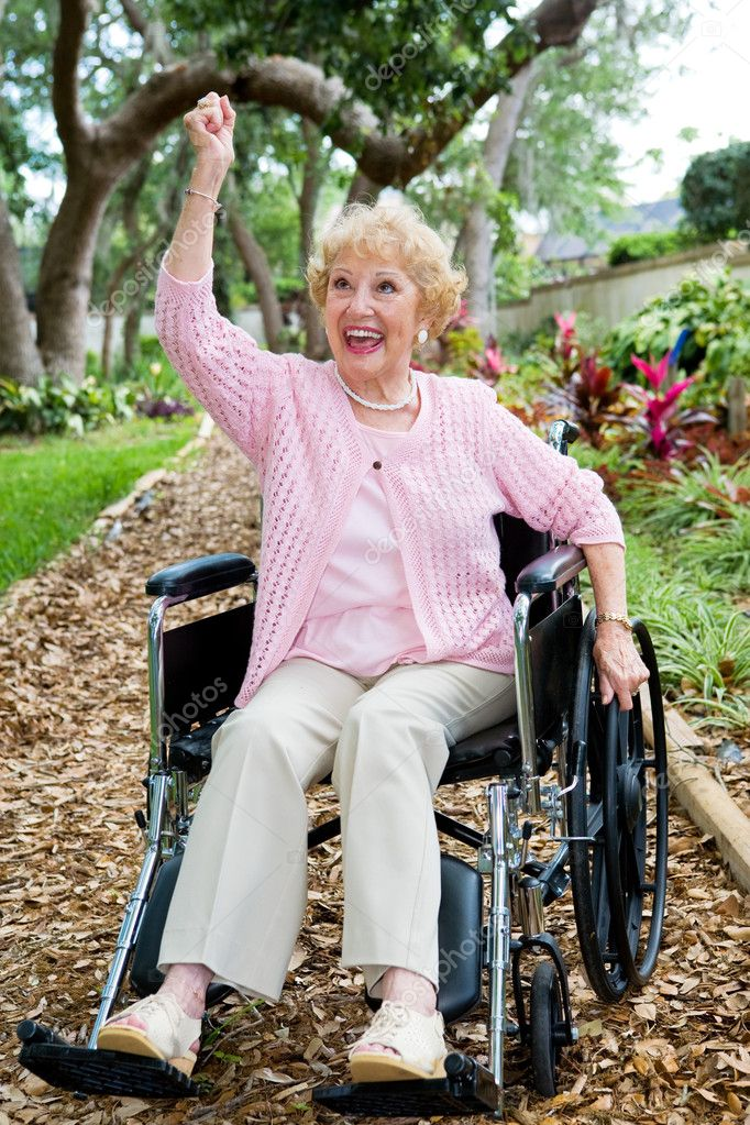 Disabled senior lady in pink, excited about achieving her health goals. — Stock Photo #6596657