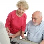 Senior Couple On Computer — Stock Photo