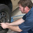 Royalty-Free Stock Photo: Mechanic Removing Lug Nuts