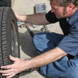 Mechanic Removing Tire — Stock Photo #6628655