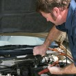 Mechanic Using Jumper Cables - Stock Photo