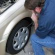Stock Photo: Removing Hubcap