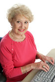 Beautiful Senior at Computer — Stock Photo