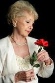 Elegant Senior Holds Rose — Stock Photo