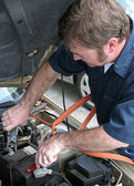 Mechanic & Jumper Cables — Stock Photo