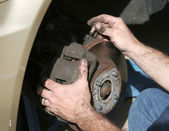 Mechanic Hands On Brakes — Stock Photo