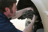 Mechanic Inserting Brake Pad — Stockfoto