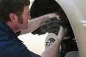 Mechanic Inserting Brake Pad — Stock Photo