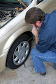 Removing Hubcap — Stock Photo