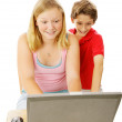 Brother and Sister on Computer — Stock Photo