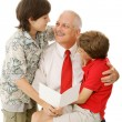 Father and Sons with Greeting Card — Stock Photo