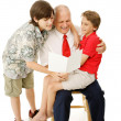 Reading Greeting Card to Dad — Stock Photo #6648797