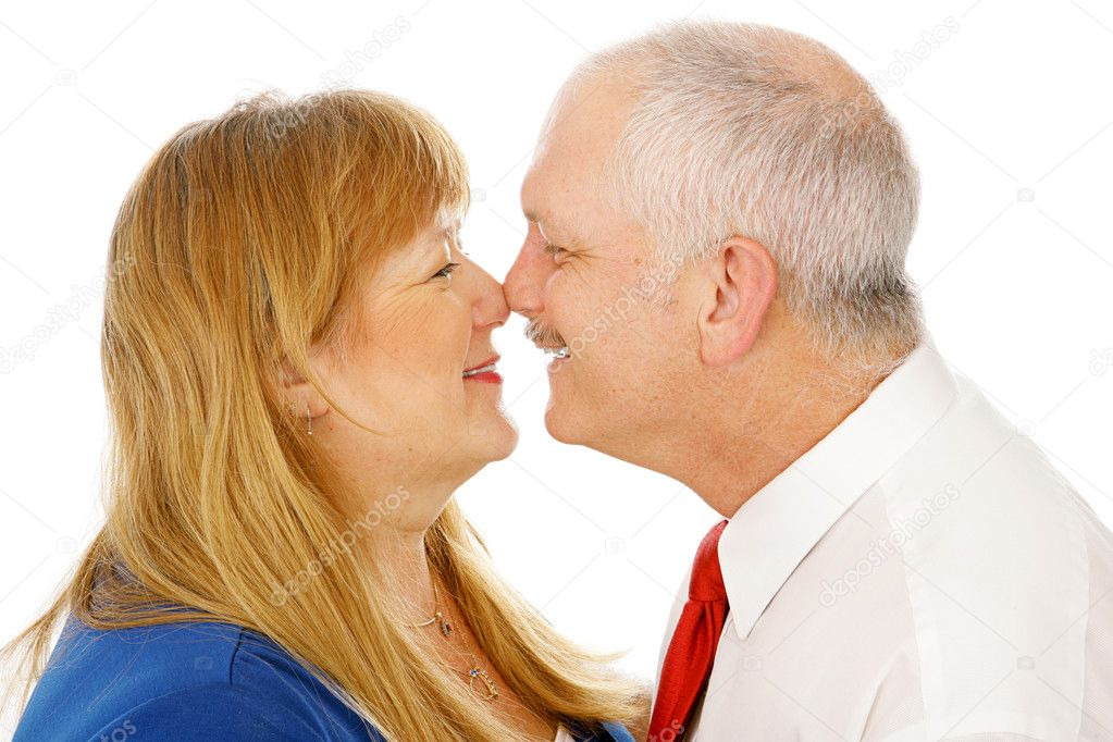 Adorable mature couple in love rubbing noses with each other. Closeup isolated on white.   — Stock Photo #6648795