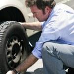 Flat Tire - Dirty Job — Stock Photo #6650630