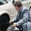Stock Photo: Flat Tire - Remove Hubcap