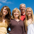 Beautiful Family & Blue Sky — Stock Photo
