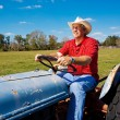 Farmer Mows the Field - Stock Photo