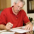 Mature Man Signing Papers — Stock Photo