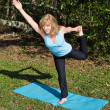 Stock Photo: Mature Woman Pilates - One Leg