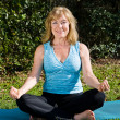 Mature Woman Yoga - Lotus - Stock Photo