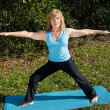 Mature Woman Yoga - Warrior Pose — Stock Photo