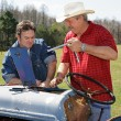 Repairing Farm Equipment — Stockfoto