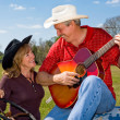 Singing Cowboy & Wife Flirting — Stock Photo #6652431