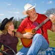 Stock Photo: Singing Cowboy - Serenade