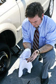 Flat Tire - Dirty Hands — Stockfoto