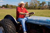 Cowboy on Tractor — Stock Photo