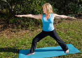Mature Woman Yoga - Warrior Asana — Stock Photo